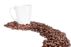 Mug and path coffee beans. Path from coffee beans on a white background Stock Photography