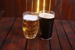Mug and pint of beer Stock Images