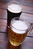 Mug and pint of beer Stock Photos