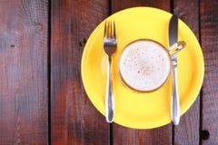 Mug on a plate Stock Photography