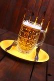 Mug on a plate Stock Images