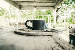 Mug raw ceramic (Do not burn)on blur background Royalty Free Stock Photography