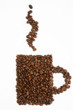 Mug shape made from coffee beans Royalty Free Stock Photos