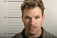 Mug shot. Police mug shot of scruffy man with mustache royalty free stock photography