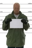 Mug shot. Criminal's mugshot, blank sign for your own text royalty free stock photos