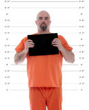 Mug shot with blank card. A mug shot of a prisoner with blank information card stock photography