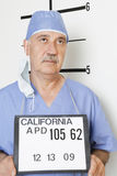 Mug shot of senior male surgeon Stock Image
