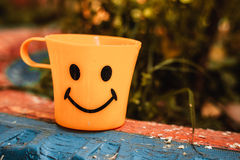 Mug with a smile. Yellow circle with a smile Stock Photo