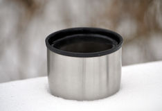 Mug in the snow. Cup of tea in the snow Stock Photography