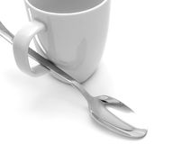 Mug and spoon Royalty Free Stock Images