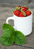 Mug with strawberries Royalty Free Stock Photo
