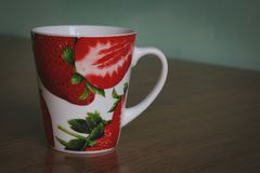 Mug with strawberry pattern royalty free stock photo