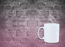 Mug with stream on concrete wall. Pink shading color on wall Stock Photos