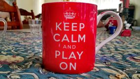 Mug and Table. A keep calm mug and a table in a lounge room Stock Photo