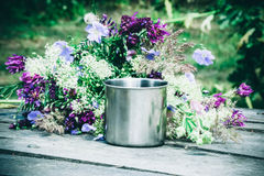 Mug is on the table with spring flowers Stock Photography