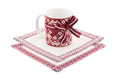 Mug and tablecloth with national latvian ornament. Isolated on white background Royalty Free Stock Image