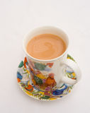 Mug of tea. A colorful mug and saucer with tea ready to drink Royalty Free Stock Images