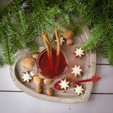 Mug of tea with christmas cookies Royalty Free Stock Photos