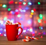 Mug Of Tea Or Coffee. Sweets. Christmas Decorations. Red Balls And Bells. Wooden Background Stock Images