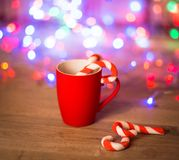 Mug Of Tea Or Coffee. Sweets. Christmas Decorations. Red Balls And Bells. Wooden Background Royalty Free Stock Photography