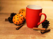 Mug Of Tea Or Coffee. Sweets. Christmas Decorations. Red Balls And Bells. Wooden Background Royalty Free Stock Images