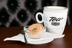 Mug of Tea and Cookies. Mug of Tea Served along with Tea Cookies in an European Pub Stock Image