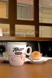 Mug of Tea and Cookies. Mug of Tea Served along with Tea Cookies in an European Pub Stock Photo