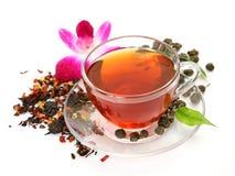 Mug with tea and a flower Royalty Free Stock Photos