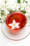 Mug with tea and flowers Stock Images