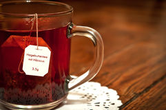 The mug of tea with a hibiscus Stock Photography