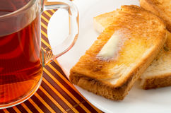 Mug of tea and hot toast with butter Royalty Free Stock Images