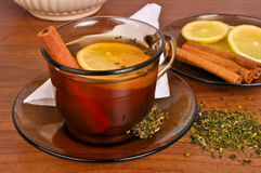 Mug of tea with lemon and cinnamon stick Stock Photography