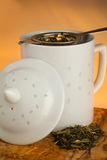 Mug with a tea strainer Royalty Free Stock Images