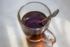 mug of tea on the windowsill in the morning Royalty Free Stock Images