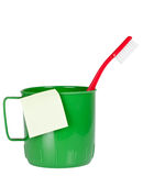 Mug and toothbrush with sticky note Royalty Free Stock Photos