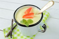 Mug with vanilla pudding Stock Photos