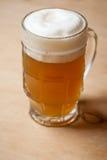 Mug of wheat beer on wood Stock Photography