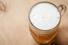 Mug of wheat beer on wood Stock Images