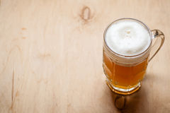 Mug of wheat beer on wood Royalty Free Stock Images