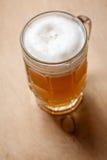 Mug of wheat beer on wood Royalty Free Stock Photo