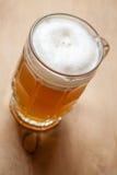 Mug of wheat beer on wood Royalty Free Stock Photography