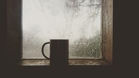 Mug on  window sill Royalty Free Stock Image