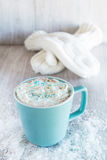 Mug of Winter Hot Chocolate With Mittens Royalty Free Stock Photography