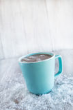 Mug of Winter Hot Chocolate With Snow Stock Images