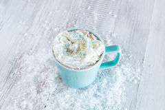 Mug of Winter Hot Chocolate With Whipped Cream and Snow Stock Photography