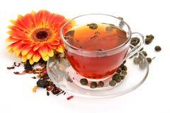 Mug With Tea And A Flower Stock Image