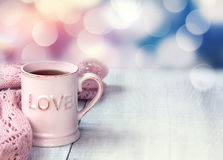 Mug on wooden table valentine`s day holiday background. royalty free stock images