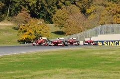 MUGELLO电路,意大利- 10月:赛巴斯蒂安・维泰尔、吉躬・赖科宁、Marc Genè和埃斯特万法拉利车队F1古铁雷斯  库存照片