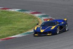 MUGELLO,意大利- 2017年4月12日:在XX法拉利赛跑的天期间节目在Mugello电路的未知数驾驶法拉利FXX K 图库摄影