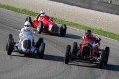 MUGELLO, ITALIË - 2007: Onbekende looppas met Uitstekende Maserati-Grand Prixauto's op Mugello-Kring bij de Gebeurtenis van Ferra royalty-vrije stock foto
